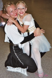My sister and I at our end of year dance recital in our stage costumes.