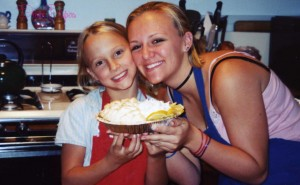 My sister and I and the lemon meringue pie we baked- half with whipped cream on top since we weren't sure how she'd react to meringue.