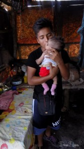 This family in Puerto Barrios, Guatemala lives and works in the local garbage dump. They now have a stash of cloth diapers thanks to donations from Lalabye Baby, Dream Diapers, and other contributors to Jake's Diapers who teamed up with Pure Joy Missions to take care of this family's diaper needs.
