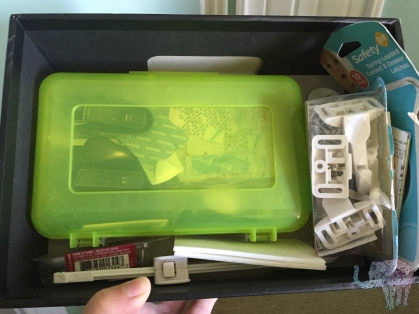 Pencil case repurposed to house 3M hooks. Silverware packaging box repurposed to hold babyproofing and frame hanging tools.